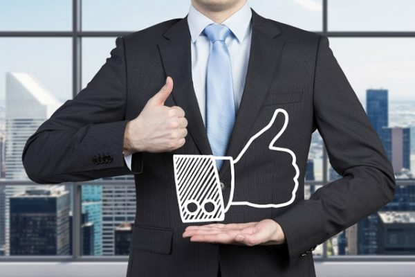 young businessman showing like symbol